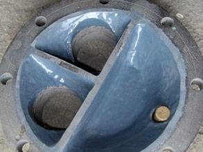 Restored and coated end cover for long-term corrosion protection
