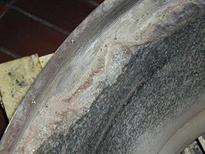 Damaged lining of vessel part caused by impact through years of service